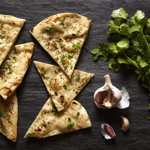 Garlic_Coriander_Naan_Bread_Sliced_Overhead